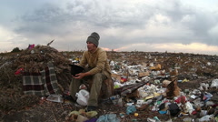 Man dump unemployed homeless dirty looking food waste in landfill  social video Stock Footage