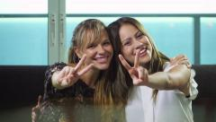 7 Two Teenagers Embracing And Showing V Sign At Camera - stock footage