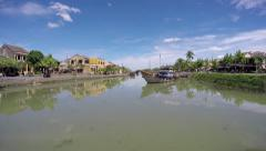 Old city Hoi An Vietnam river yellow building blue boat footage from bridge 4k Stock Footage