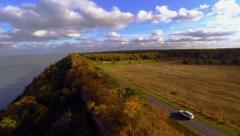 Autumn sunset. Cliff and fields. Aerial footage Stock Footage