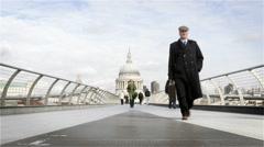 Time lapse: Millennium Bridge walkers, London, UK Stock Footage