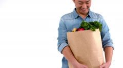 Stock Video Footage of Asian smiling man holding a food bag