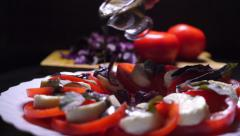 Pouring balsamic sauce on tomatoes and mozzarella cheese salad Stock Footage