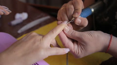 Manicure. The device removes the cuticle Stock Footage