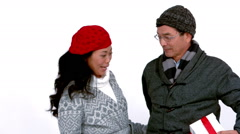 Couple in warm clothing holding gift Stock Footage