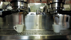 Coffee machine pouring coffee in small cups Stock Footage