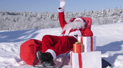 Santa Claus relaxing in snow covered winter forest Stock Footage