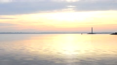 Time lapse with water landscape, lighthouse and sky at dawn Stock Footage