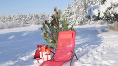 Gift bag under Christmas tree in snow covered winter forest Stock Footage