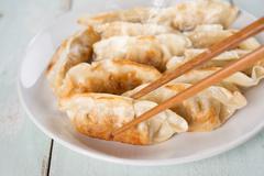 Asian appetizer pan fried dumplings Stock Photos
