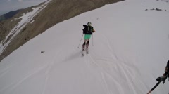 The descent from the high mountain skiing on fresh snow Stock Footage
