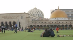 Muslim people enjoying on square at Mosque,Bandung,Java,Indonesia Stock Footage