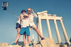 Family Take A Selfie Video On The Antique Colonnade View.Temple of Apollo,Turkey Stock Photos