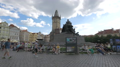 People sitting near Jan Hus Memorial in Old Town Square, Prague Stock Footage