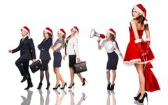 Woman in Santa Claus costume with business people Stock Photos