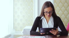 Young beautiful girl in glasses  freelance business works distant work on the Stock Footage