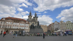 People passing by Jan Hus Memorial in Old Town Square, Prague Stock Footage