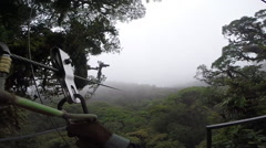 GoPro point of view zipline over Costa Rican tropical rainforest Stock Footage