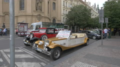 Sightseeing with two vintage cars, on Parizska street in Prague Stock Footage