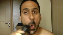 A man shaves (fast). Stock Footage