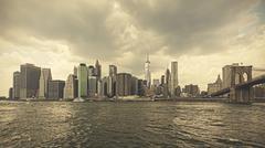 Retro toned stormy sky over Manhattan, NYC, USA. Kuvituskuvat