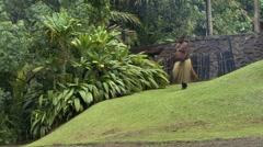 FijI Tribesman walking to fire Stock Footage