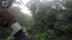 GoPro fast zipline point of view over Costa Rican tropical cloud forest Stock Footage