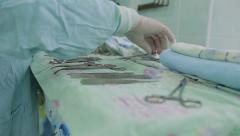 Nurse preparing medical surgical instruments before surgery - stock footage