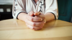 Frowning woman waiting at the table Stock Footage