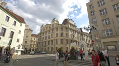 People walking in Franz Kafka Square on a cloudy day, Prague Stock Footage