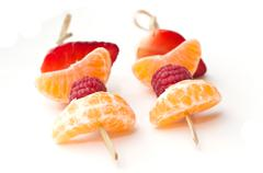 duo of fruits skewers presentation - stock photo