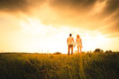 Silhouette of a Two Persons On Sunset - stock photo