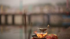 Authentic Holy incense stick lighting near Ganga River in Indian Temple Stock Footage