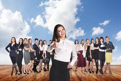 Group of business people stand under clouds sky. Stock Photos