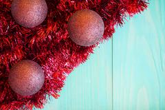 Stock Photo of Red tinsel and Christmas balls