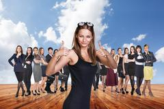 Group of business people stand under clouds sky. - stock photo