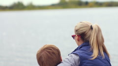 Love couple hugs at the river Stock Footage