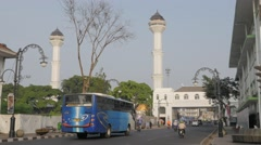 Traffic on road in centre with mosque,Bandung,Java,Indonesia Stock Footage