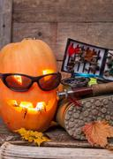 halloween pumpkin with wading boots and fly-fishing - stock photo