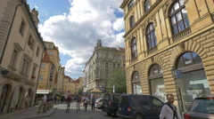 People walking on Melantrichova street on a cloudy day, Prague Stock Footage