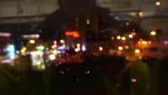 Traveller point of view. City light POV rainy through train window at night Stock Footage