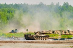 Stock Photo of Bridge layer MTU-72 in action under tank cover