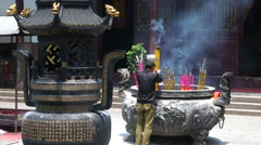 Buddhist pay respect for Buddha in Yingjiang Temple at Anqing, China Stock Footage
