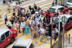 Busy pedestrian crossing at Hong Kong - stock photo