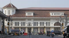 Dutch colonial building with traffic,Bandung,Java,Indonesia Stock Footage