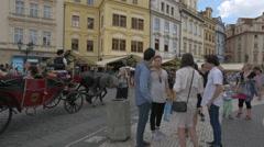 Velvet carriage with tourists heading to Small Square (Malé náměstí), Prague Stock Footage