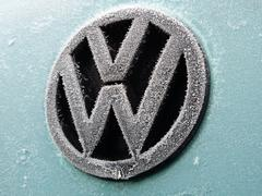Volkswagen - a German car manufacturer - logo covered with frost - Warsaw, Po - stock photo