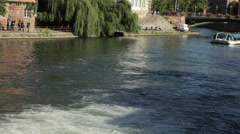 Tour boat at water canal in Strasbourg, France Stock Footage