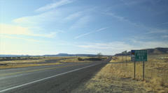 Route 66 road sign near Seligman, Arizona Stock Footage