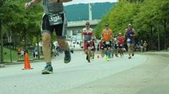 Editorial: marathon runners in iron man - stock footage